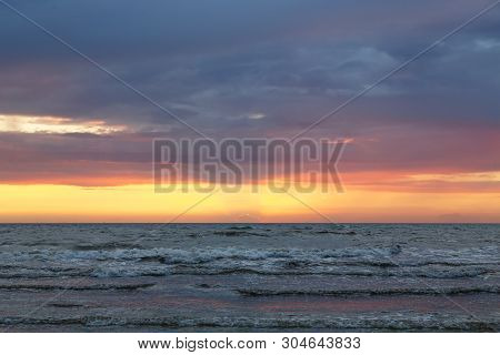 Sunset Over The Baltic Sea With Cloudscape