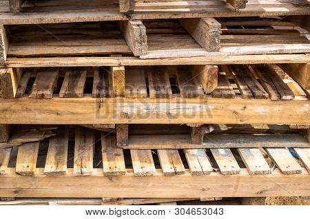 Old And Used Palate Wood Timber On The Construction Work Site.