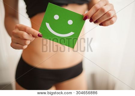 Women Health. Closeup Of Healthy Female With Beautiful Fit Slim Body In White Panties Holding White