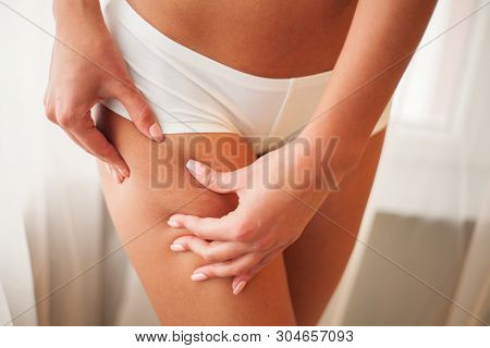 Weight Loss. Closeup Of Hot Sexy Female With Hand Pinching Skin poster