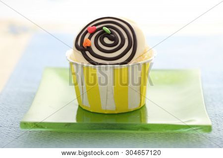 Colourful Cupcakes On A Plate In Close Up