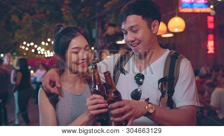 Traveler Backpacker Asian Couple Travel In Bangkok, Thailand, Sweet Couple Drinking Alcohol Or Beer