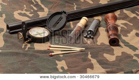 Subjects of the hunting ammunition on a camouflage fabric. poster