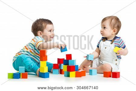 Two Babies Building Block Towers. Isolated On White Background