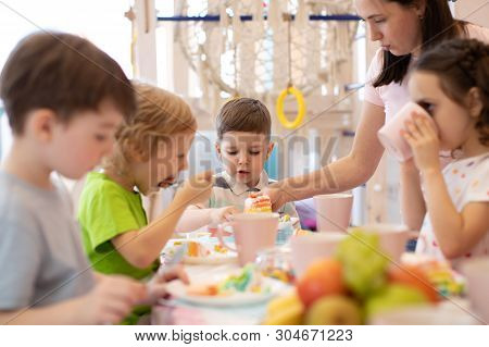 Kids Eat Festival Cake At Holiday In Daycare