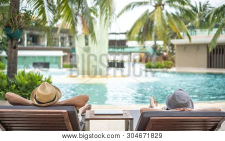 Summer Resort Hotel Stay Relaxation With Tourist Traveller Couple Take It Easy Happily Resting On Be