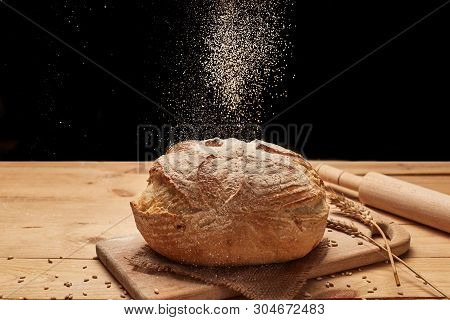Freshly Baked Bread. Loaf Of Bread On Wooden Background, Food Closeup. Bread At Leaven. Unleavened B