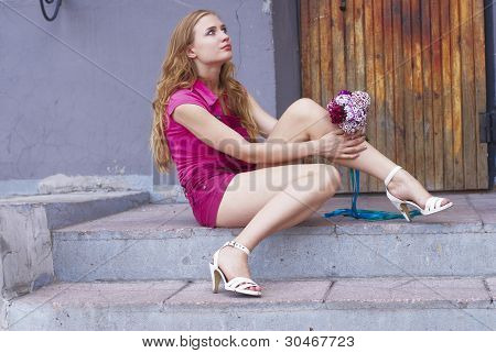 Waiting girl with bouquet