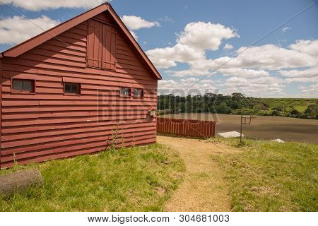 Historic Settlers Red Barn In Rural Countryside