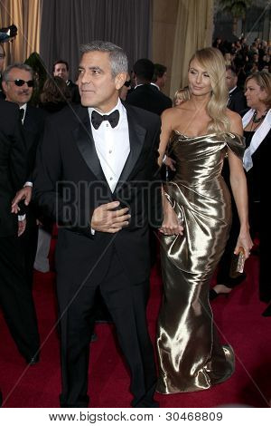 LOS ANGELES - FEB 26:  George Clooney; Stacy Keibler arrives at the 84th Academy Awards at the Hollywood & Highland Center on February 26, 2012 in Los Angeles, CA.