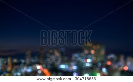 Night View Of A City With Countless Buildings Very Close To Each Other.