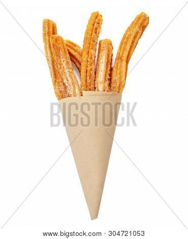 Churro Stick In Apaper Bag.  Churro - Fried Dough Pastry With Sugar Powder Isolated On A White Backg