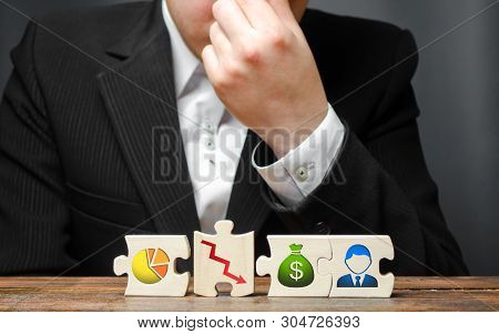 Man From Overstrain Holds His Hand On The Nose Or Forehead On The Background Of The Business Process