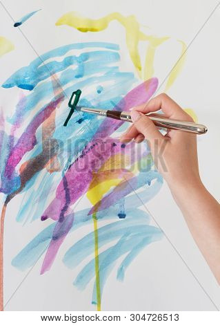 Abstract Strokes Of Different Colors With A Brush And Water Colors On Paper, Easel