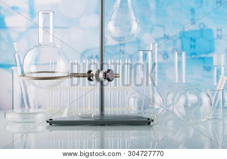 Chemical Laboratory. Various Utensils For Experiments, Glass Bottles And Tubes