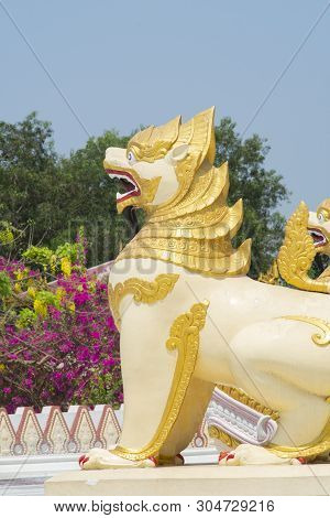 Stone Lion At Entrance Of Shwedagon Pagoda In Rangoon (myanmar)