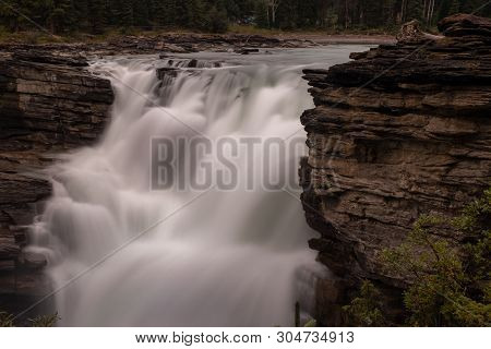 A Close Up Of The Mighty Athabasca Waterfall In Banff National Park, Canada, The Torrent Of Water Sq
