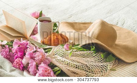 Still Life Details In Home Interior Of Living Room. Cup Of Tea With Pions Flowers And Spring Decor O