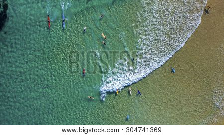 Aerial View Of The Turqoise Tide Coming Into The Beach With Surfers At The Pass Byron Bay
