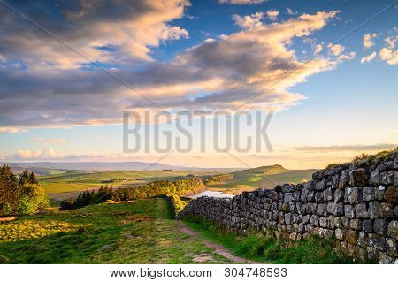 Hadrian's Wall above Hotbank Crags, a UNESCO World Heritage Site in the beautiful Northumberland National Park. popular with walkers along the Hadrian's Wall Path and Pennine Way