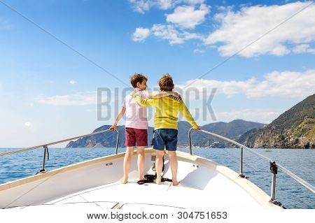 Two Little Kid Boys, Best Friends Enjoying Sailing Boat Trip. Family Vacations On Ocean Or Sea On Su