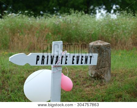 A Creative Sign Made From A White Picket Used In A Fence.
