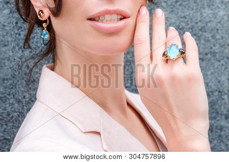 People, Fashion, Jewelry And Luxury Concept, Closeup Of Woman Wearing Luxury Jewelry. Color Gemstone