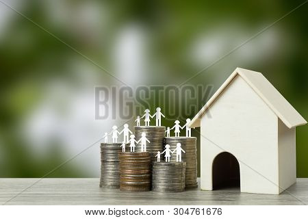 Home Loans, Cheap Home Projects, First Homes To Start A Family Concept. Family Member On Stacked Coi