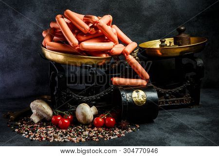 Large Heap Of Raw Long Thin Wieners On Antiquarian Scales
