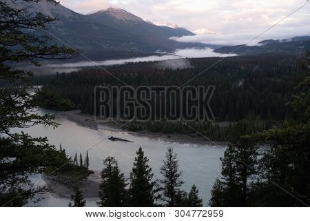 A View At Daybreak  Of Jasper And The Athabasca River As It Weaves Its Way Through The Jasper Nation