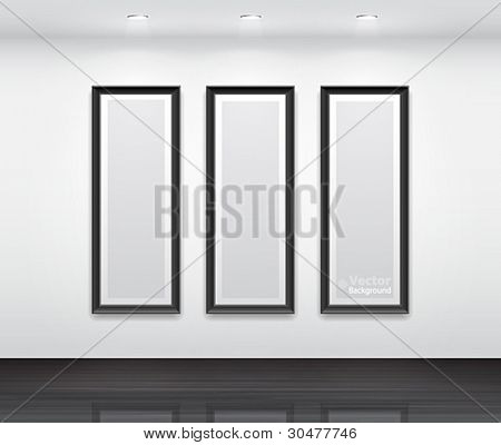Gallery Interior with empty black frames for triptych.