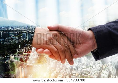 Partnership. Double Exposure Image Of Investor Business Man Handshake With Partner For Successful Me