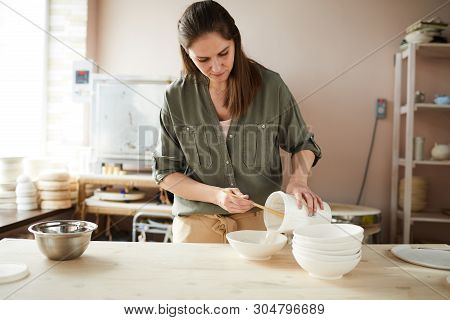 Waist Up Portrait Of Female Ceramist Working In Pottery Studio, Copy Space