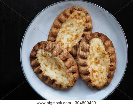 Traditional Finnish Karelian Pies On Black Background