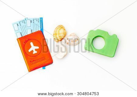 Funny Vocation Concept With Camera, Passport And Tickets On White Background Top View