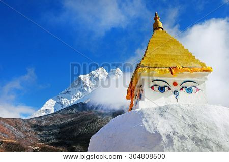 Buddhist Stupa And Prayer Flags In The Himalaya Mountains, Everest Region, Nepal