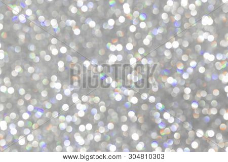 Glitter Silver Background, De-focused, Macro. Sparks Fall And Sparkle, Free Space. Bokeh Silver. Shi