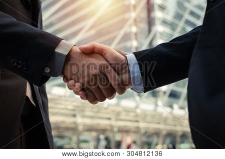 Partnership. Close Up Business Man In Modern Suit Hands Shaking After Finishing Up A Business Meetin