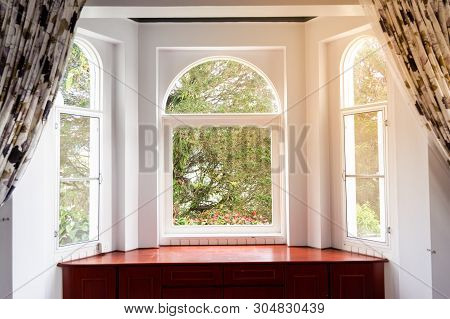 Refreshing Sunrise, Greenaries, Nature View From Home Interior Through Glass Window In  Tropical Hig