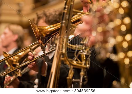 trumpet section during a classical concert music, close-up.