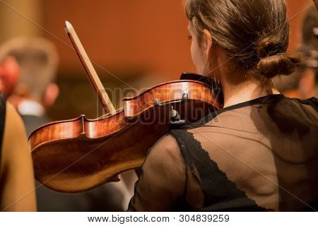Violinist player during a classical concert music, close-up.