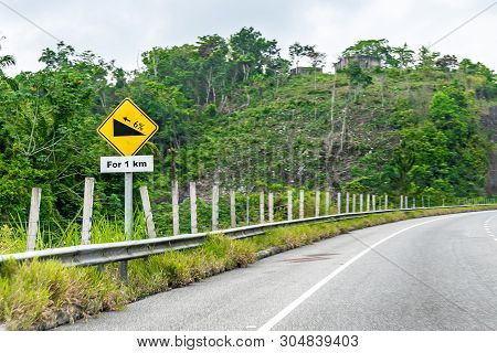 Yellow Caution Ascent 1km Uphill 6% Incline Street Traffic Arrow Symbol Sign On Dual Carriageway Hig