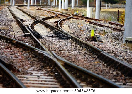 Close up railroad tracks on countryside landscape