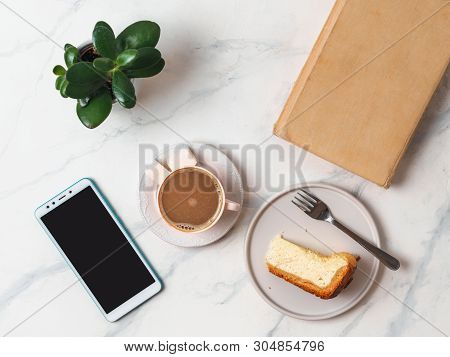 Coffee And Cheescake On White Marble Tabletop. Top View Or Flat Lay. Coffee Cup, Piece Of Cheesecake