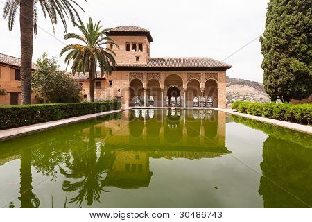 Alhambra Palace Of Granada Reflected In Water