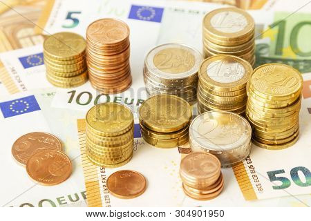 Stack Of Euro Coins On Euro Banknotes, For Backgrounds. Germany