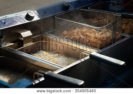 Deep-fried Potatoes. French Fries Fried In Boiling Oil In A Fryer. Street Food.