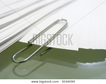 Pile Of White Bond Paper With Metal   Clip