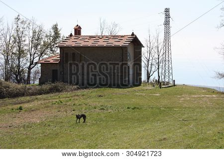 small church abandoned, in disuse, on the Apuan Alps of the Tuscan Apennines in a clearing on a sunny spring day poster
