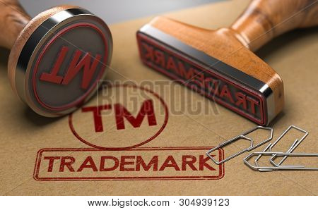 3d Illustration Of Two Rubber Stamps With The Word Trademark And The Symbol Tm Over Brown Paper Back